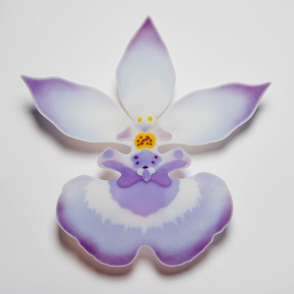 glass art sculpture of exotic flower in white and mauve