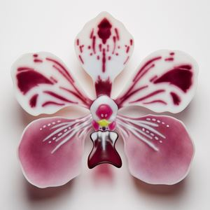 sculpted glass art of an exotic flower in pink and white