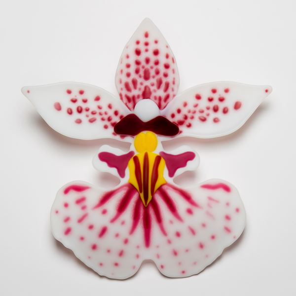 glass art sculpture of exotic flower in white pink and yellow