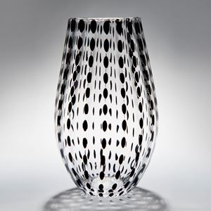 selection of clear melon shaped vases in various spotted colours