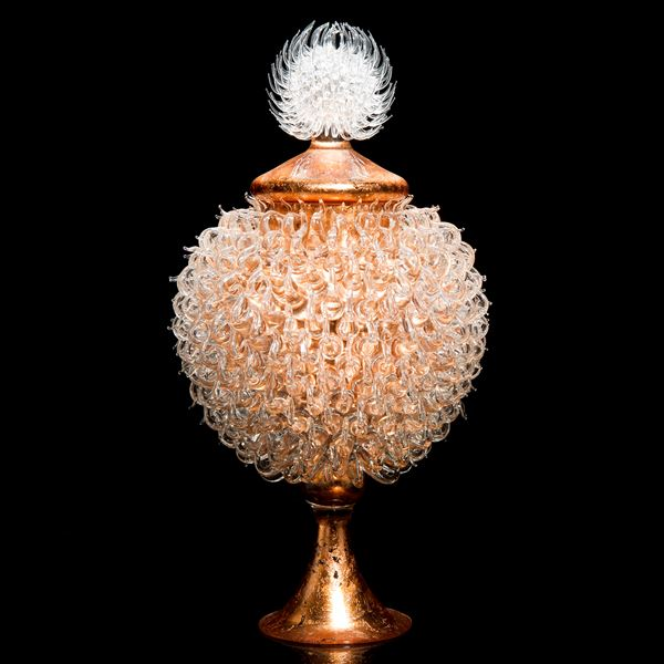 pink bronze glass sculpture of round jar atop cone shaped base with white thistle top