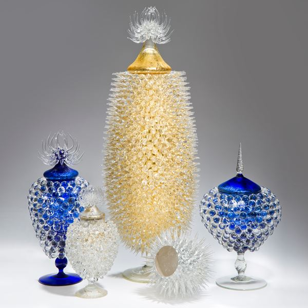 art glass sculpture of urchin in white with gold centre