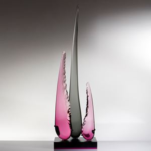 abstract sculpted glass artwork of three long glass shards one long black in the centre and two shorter in purple to either side