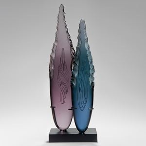 two plum and blue glass shard sculptures on black rectangular base