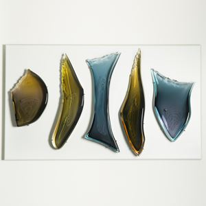 wall mounted glass art sculpture of primitive tool like shapes in dark blue and yellow