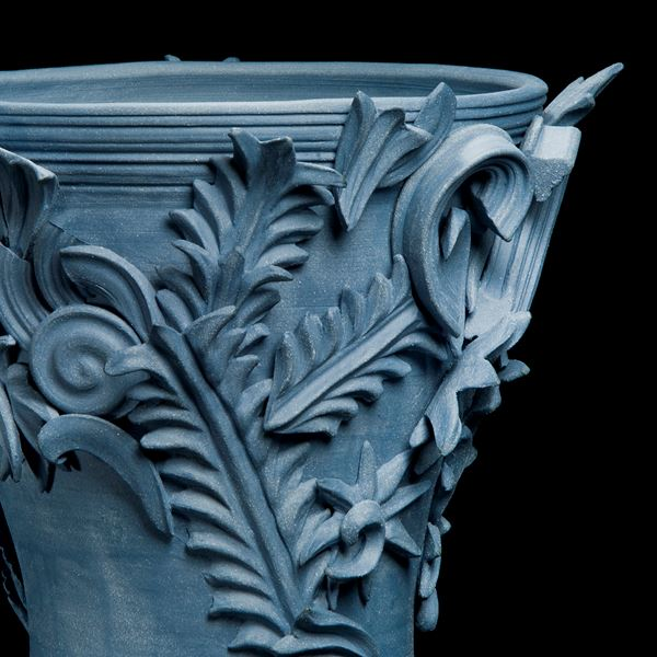 blue contemporary ceramic vase sculpture in classical style with classical flower trim