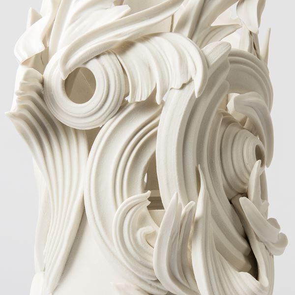 ceramic sculpture in grey of decorative swirls