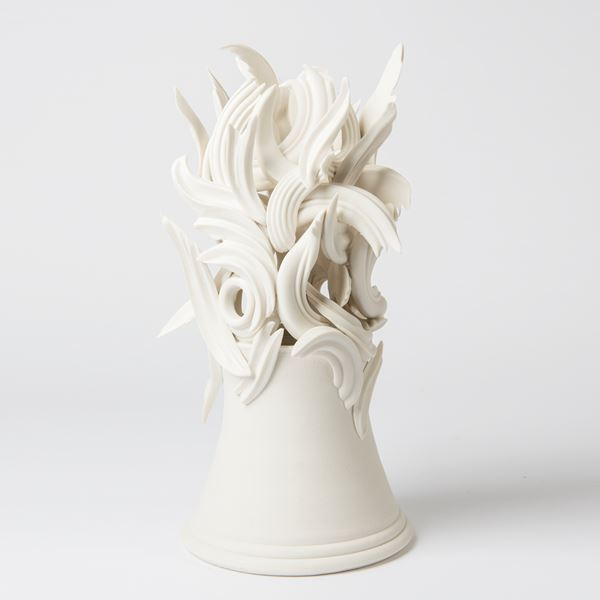 white ceramic sculpture of decorative architrave on potted base