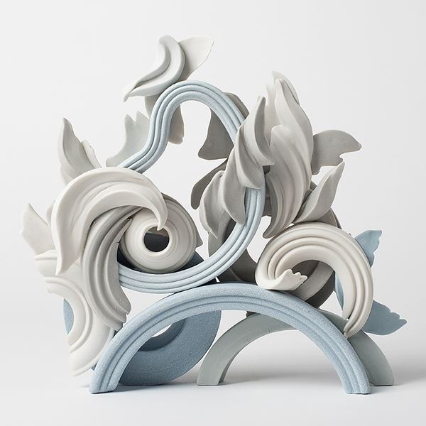 porcelain sculpture of classical decorative floral shapes in cream and light blue