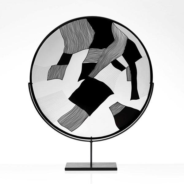 round modern glass art sculpture in black and white on steel stand