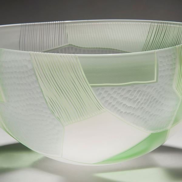glass art bowl sculpture in green and white