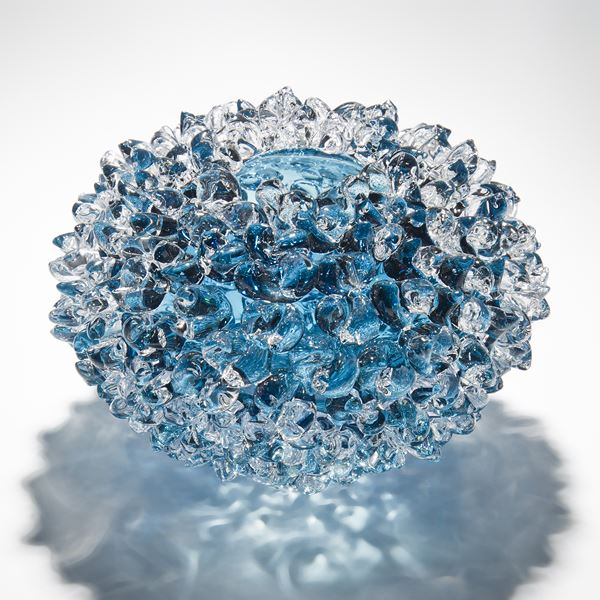 modern handblown art glass ornament of crystals in flower form in blue