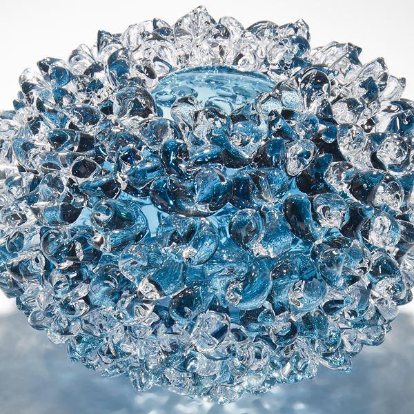 modern handblown art glass ornament of crystals in flower form in blue