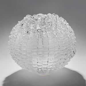 handblown spherical contemporary art glass sculpture in opaline arranged from small individual shards