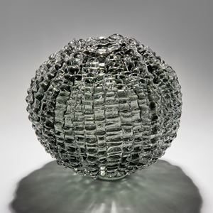 handblown spherical contemporary art glass sculpture in grey arranged from small shards