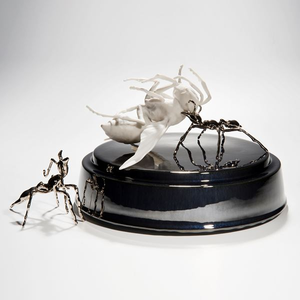ceramic and metal sculpture of hornet and ants on round base