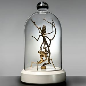 metal glass and porcelain sculpture of ants trapped in tall dome