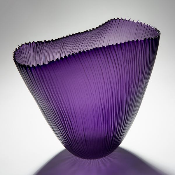 purple hand cut glass sculptre of wide open top basket with ribbed edge