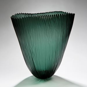 tall open sculpted green vessel with ribbed pattern