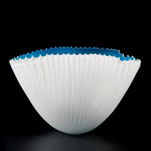 decorative hand cut art glass bowl with white exterior and blue interior