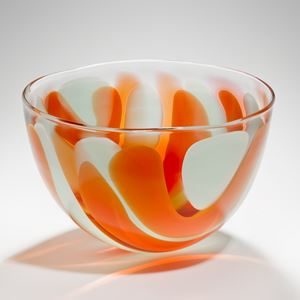 small bowl glass sculpture with orange and white swirls resembling colours of an egg