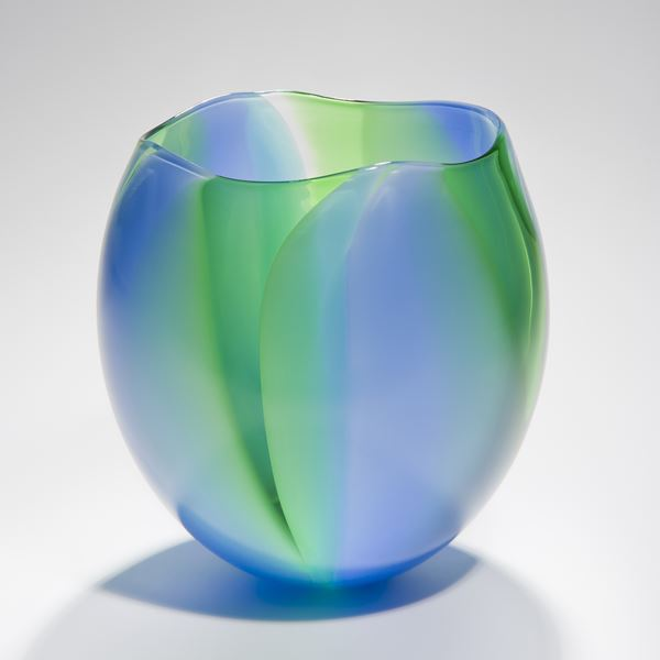 medium height sculpted glass bowl or vase in blue and green