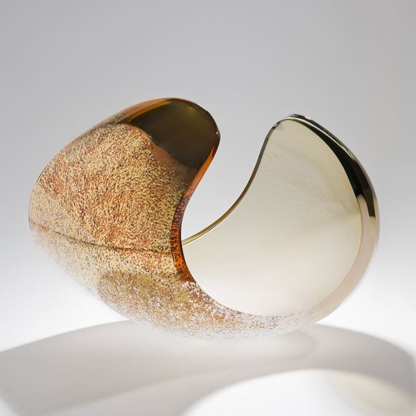 detailed glass sculpture of concave shape in beige bone white and gold
