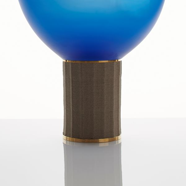 contemporary art glass sculpture resembling lightbulb of blue oval shaped top resting on bronze base