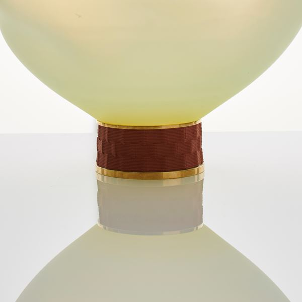 cream art glass sculpture of blob shaped blown glass with bronze base