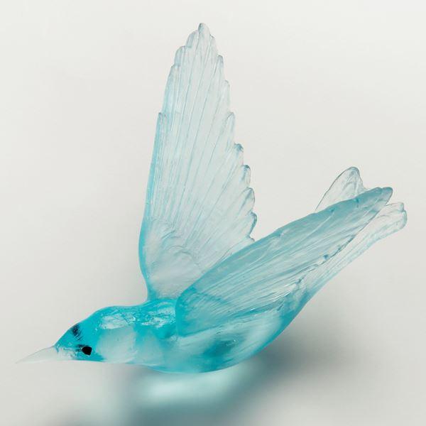 light green art glass sculpture of a bird