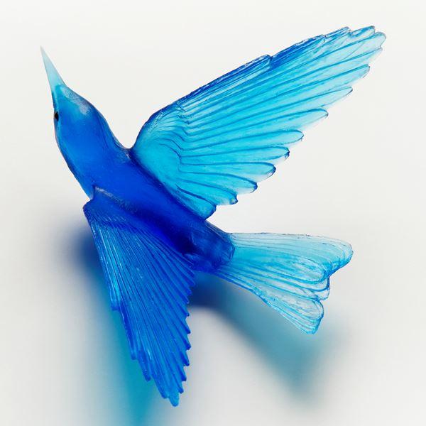 glass sculpture of a bell bird in blue