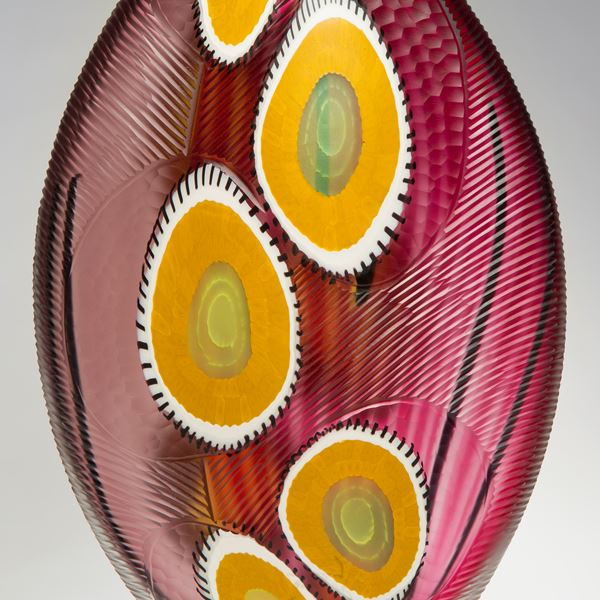 sculpted glass vase in bright colours with large yellow dots