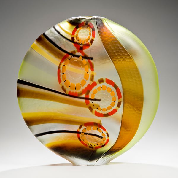 round art glass vase in green brown red and orange