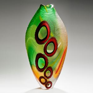 tall bright green art glass vase with red round patterning