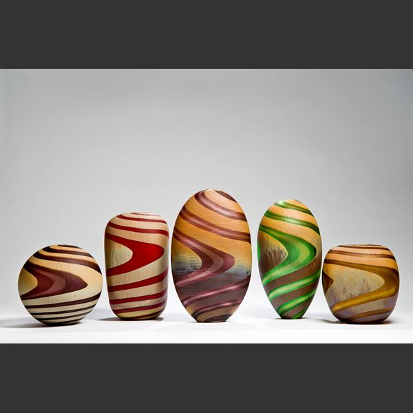 art glass vases in various shapes and colours with swirling colour