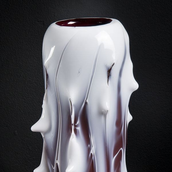 abstract tall glass sculpturein white with protruding edges and slightly melted look