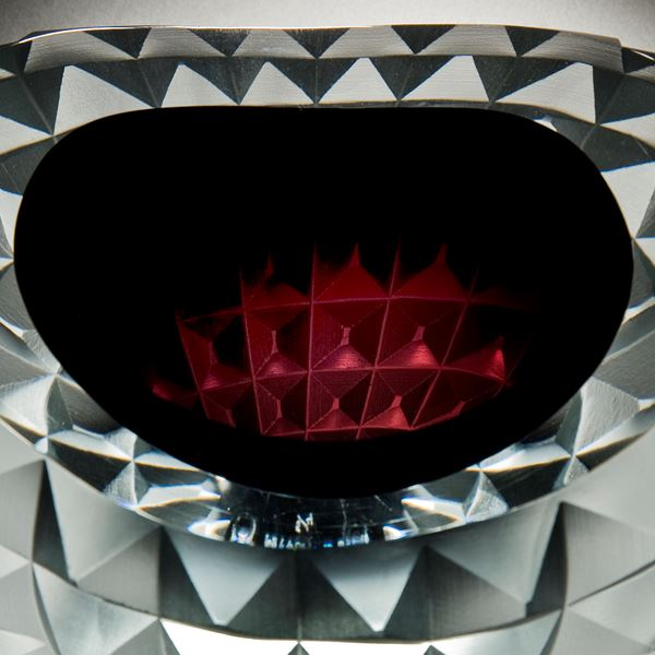art glass bowl with pyramid stud shaped exterior in red black and white