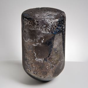 glass sculpture made to resemble natural stone in the shape of a bullet