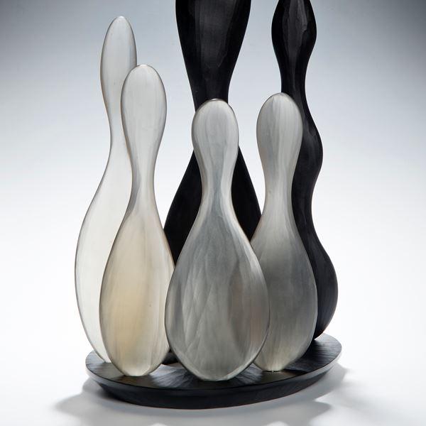 still life art glass skittles in black and white glass on black base