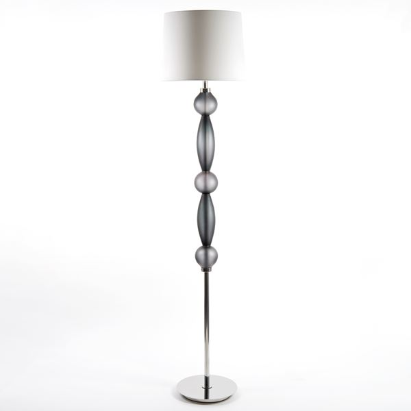 tall floor light made from steel and cut glass adornments