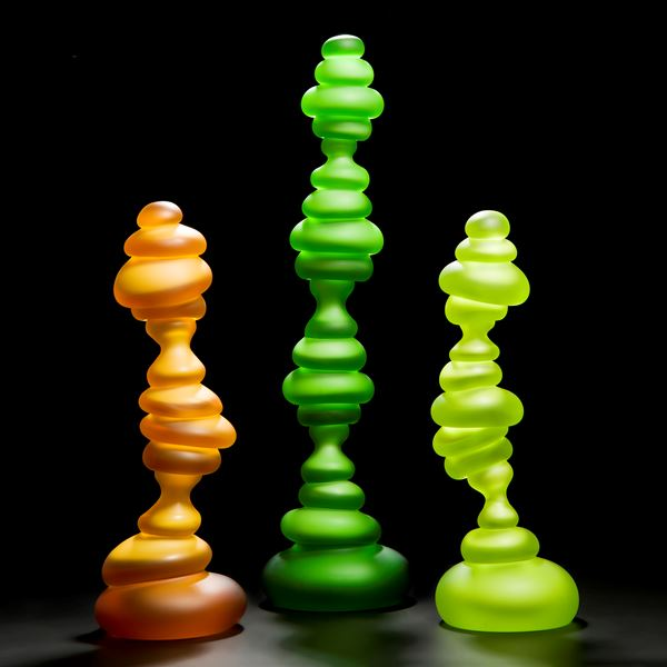 three tall neon blob shaped abstract art glass sculptures