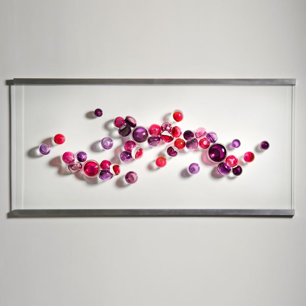 minimalist glass art wall hanging artwork with white background and berry coloured round glass pieces