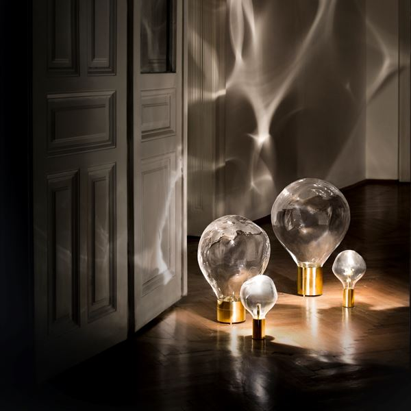 glass art moving lightbulb collection with brass base
