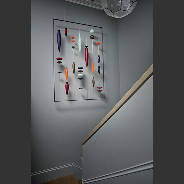wall-mounted blown glass art sculpture with steel frame