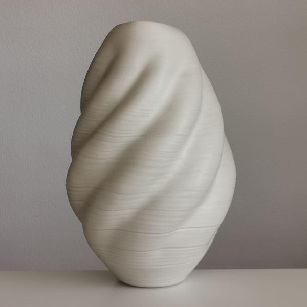 sculptured ceramic vessel vase in cream with ripple effect