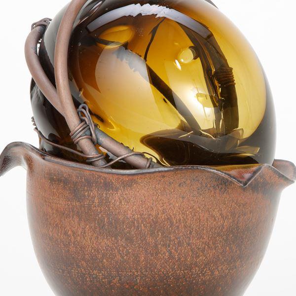 ornate modern handblown glass art sculpture in copper wire