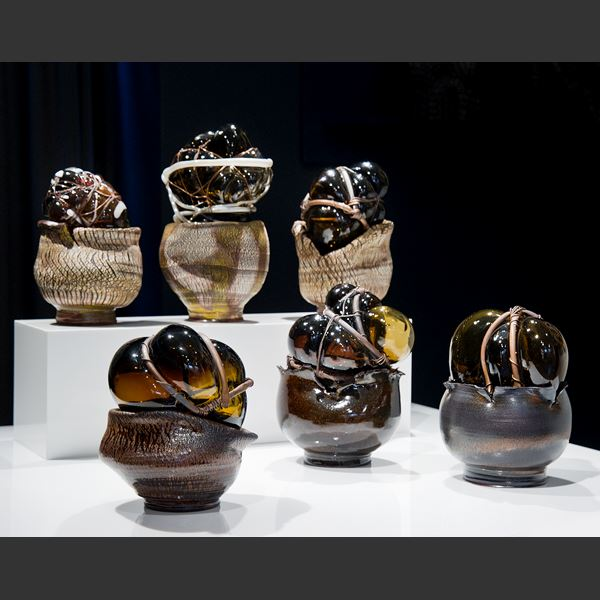 handblown and sculpted modern art glasswork of heart shaped glass in copper wire