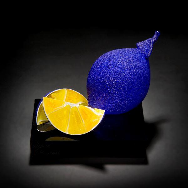 blue and yellow still life glass art sculpture of lemons