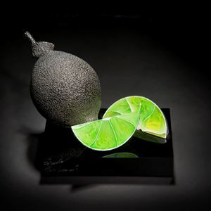glass sculpture of lime as still life piece of art