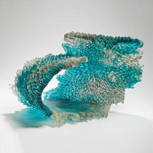 cast and scuplted art glass ornament inspired by nature in clear and turquoise